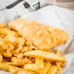 Proper Chip Shop fish and chips are a thing of great beauty and possibly the most evocative memory of growing up in the UK. Served with a dollop of tomato sauce it's a perfect naughty weeknight meal! #Englishfishandchips #beerbatteredfish