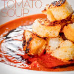 With a little bit of extra effort you can elevate a simple roasted tomato soup to a whole new taste level with hints of thyme and lots of roasted garlic. Surprisingly it only takes 15minutes prep to make this homemade tomato soup. #soupideas #tomatosoupfromscratch