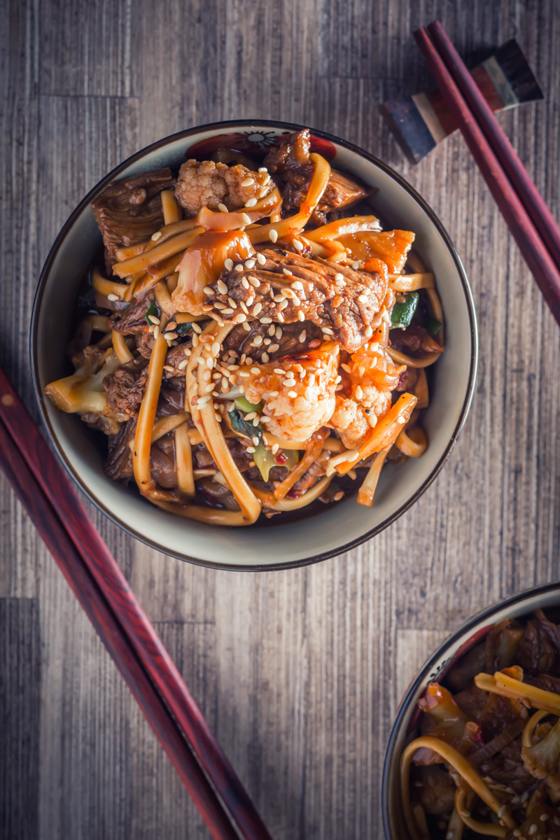 A wonderfully simple noodle based beef stir fry dish with hints of Szechuan pepper and chili and all ready in less than 20 minutes.