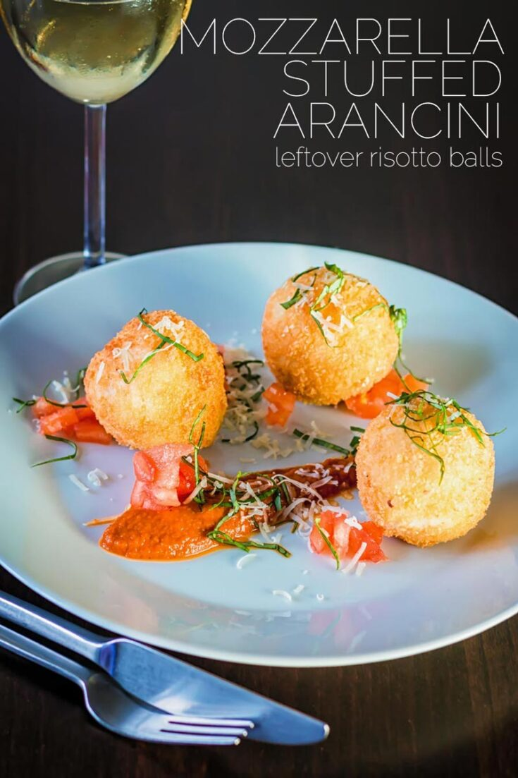 The Italians are responsible for some of the most wonderful comfort food ever devised and these Mozzarella Cheese stuffed Arancini balls are crusty, crunchy on the outside and soft and cheesy on the inside #italianriceballs #leftoverrisottorecipes