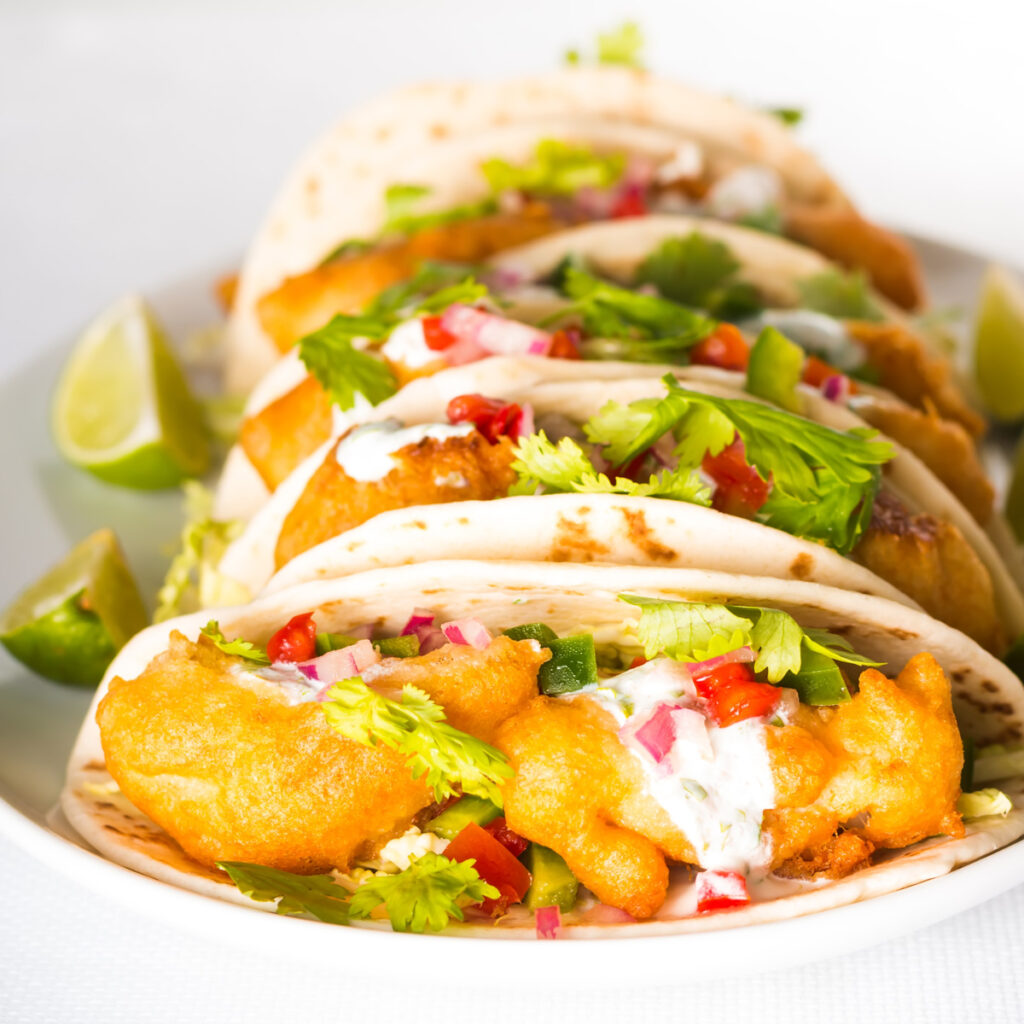Some glorious beer battered fish tacos are thing of great beauty, loaded with the flavours of cumin, coriander and lime!