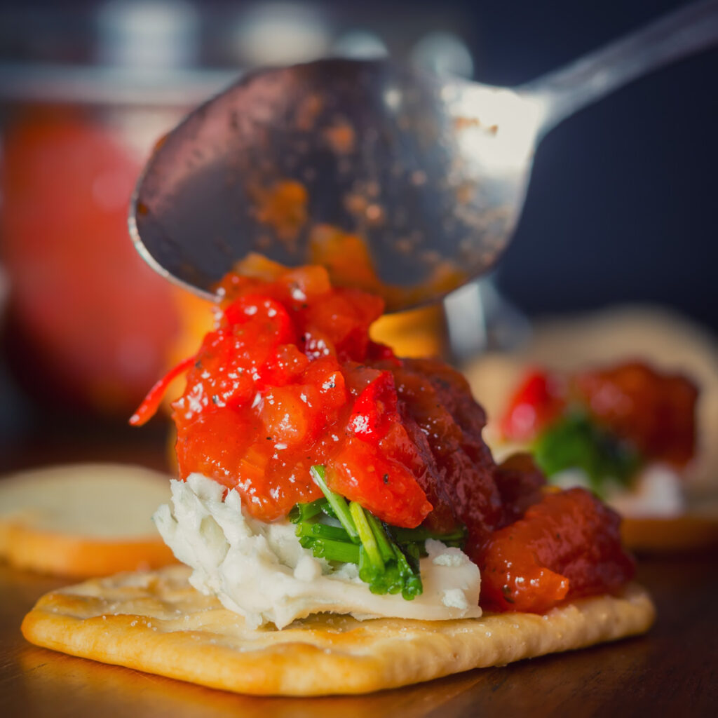This tomato and Chili Jam is so versatile, every thing from a topping to Crostini through to a glaze for pork or chicken.