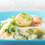 This Tuscan cabbage and white bean soup is super creamy but uses no cream thanks to a really old school trick! It makes for a fantastic hearty lunch or light dinner!