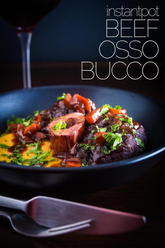 Beef Osso Bucco is a more accessible version of the Italian Veal Classic, cooked in the Instant Pot means it is also a whole bunch quicker but every bit as tasty served with cheesy polenta and a rich red wine and port sauce. #beefrecipes #instantpotrecipes #dinnerfortwo #ossobuccorecipe #polentarecipe #italianrecipes