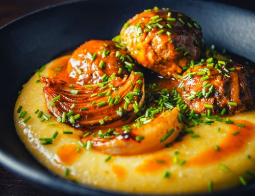 Braised Pork Meatballs in a Beer Sauce on Cheesy Polenta