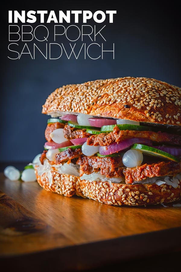 This BBQ Pork Sandwich is cooked in the InstantPot and then blasted in the oven, the served on a ciabatta style loaf with lots of pickles.