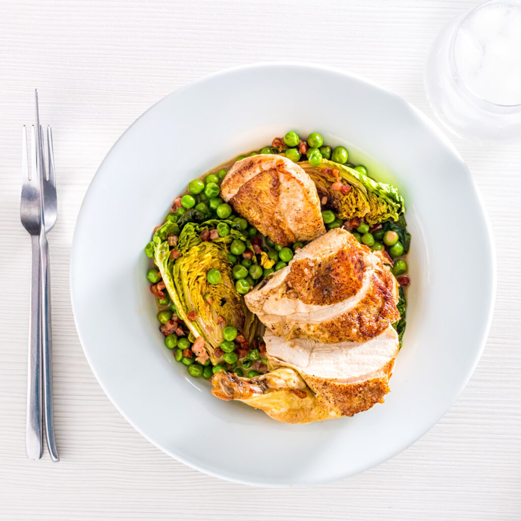 Don't be put off by the fancy name Petits pois a la Francaise is a simple rustic braised pea and lettuce dish from France and I serve it with a perfectly Roasted Chicken Breast.