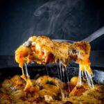 This cheesy skillet baked gnocchi is the perfect simple home cooked meal, a zingy tomato sauce and lots of melted cheese, what's not to love?