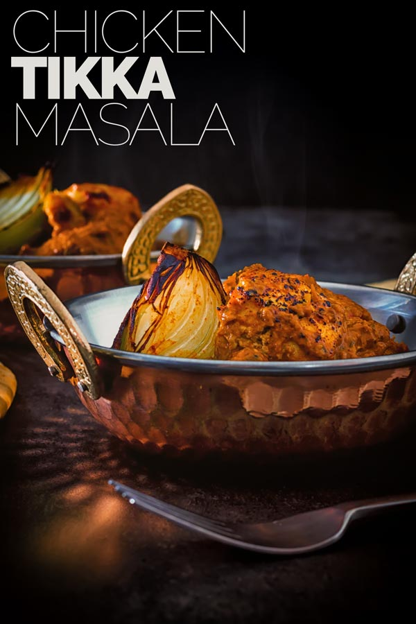 Tikka Masala is a versatile dish that can be meat or vegetarian and is the Grand Daddy of Anglo Indian Curries. My chicken tikka masala recipe features traditionally grilled marinated chicken in a spicy fragrant tomato based sauce. #britishindiancurry #chickencurry
