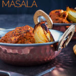 Portrait image of a steaming chicken tikka masala curry served in a copper lined curry bowl with a fork against a dark backdrop with text