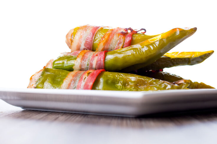Stuffed green peppers wrapped in bacon packed with porky goodness with hints of dried apricot and a generous helping of fresh cayenne pepper for heat.