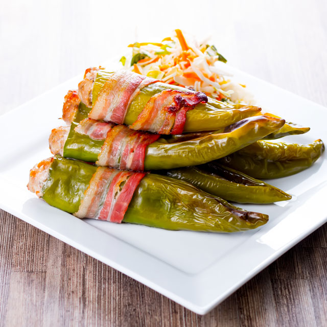 Stuffed green peppers wrapped in bacon packed with porky goodness with hints of dried apricot and a generous helping of fresh cayenne pepper for heat
