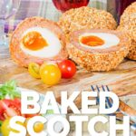 Cut open baked scotch egg in a picnic setting with tomatoes on a purple tartan picnic blanket on a sunny day with text