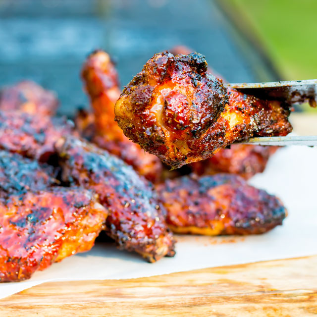 These Sriracha Glazed Wings are marinaded in a dry rub before being grilled on the BBQ in a sticky spicy sweet sauce to send them over the edge.