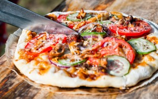 Cooking pizza on a BBQ is a revelation and what better place to start than a sweet and smokey BBQ Chicken Pizza loaded with all the goodies.