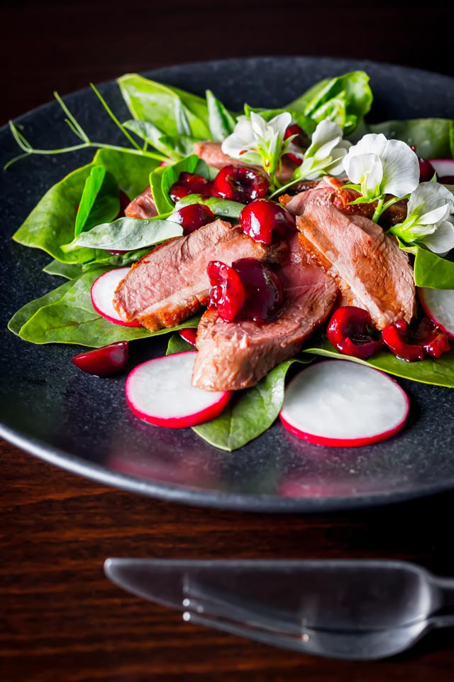 Lovely rich duck breast is the perfect match to seasonal cherries and the sharp sweetness of balsamic in this great summer duck salad.