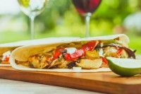 My Grilled Cilantro Chicken Fajitas are a sideways look at a classic fajita going heavy with a cilantro paste marinade and grilled peppers.