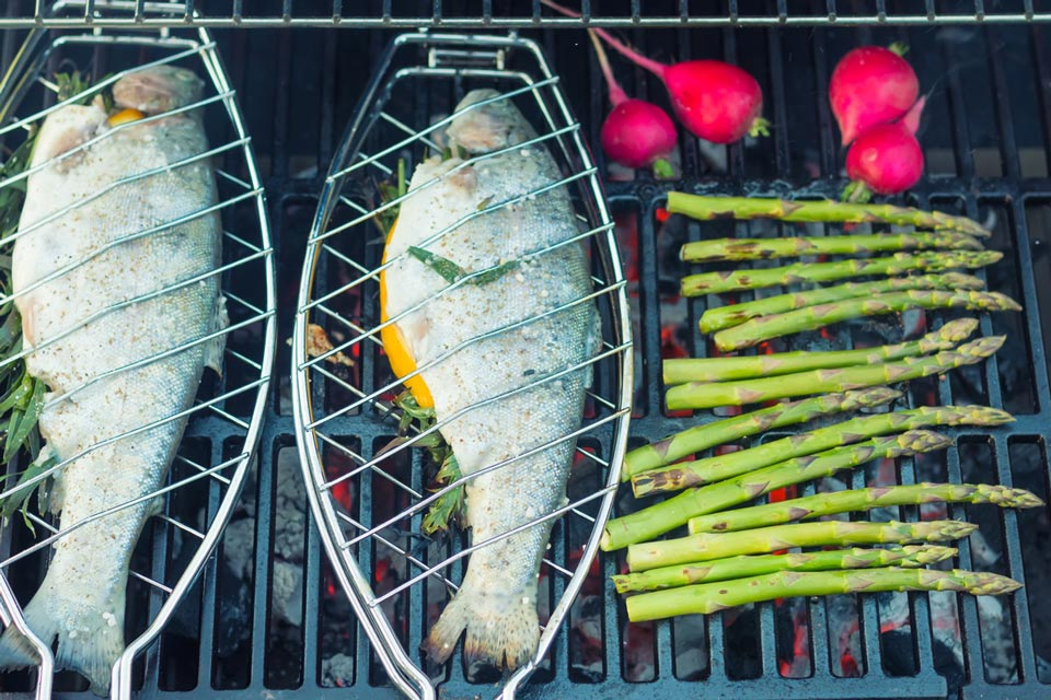 Grilled trout over an open flame could not be easier to cook and lets face it, fish cooked over an open flame is a thing of great beauty.