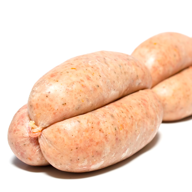 Homemade linked pork sausages on a white background