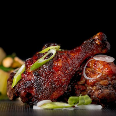 Finger Licking Sticky Chicken Drumsticks coated with a rich and dark glaze heavy with chili, perfect from the oven but would work equally well on a BBQ!