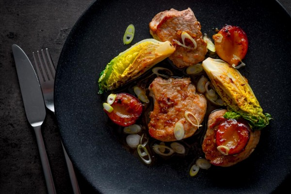 """This Chinese pork tenderloin is a sideways glance at the idea of pork and plum sauce but we play with some """"grilled"""" plums and Chinese five spice."""