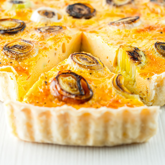 This Leek and Gruyere Quiche is a little play on the classic idea of a cheese and onion quiche using nutty almost smoky Gruyere cheese & charred leeks.