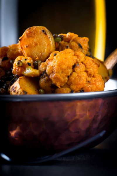Aloo Gobi is a glorious potato and cauliflower curry and originally from the the Punjab mine comes with a fab surprise 'crispy' element in the shape of fried mung beans.