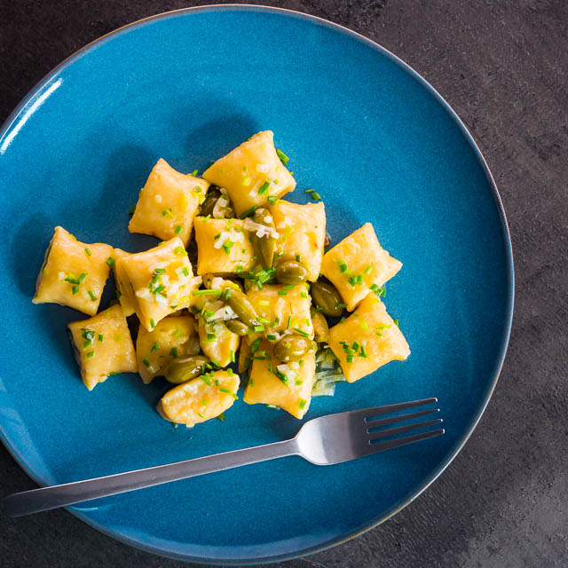 These ricotta cheese gnocchi are the altogether lighter, quicker and much more simple brethren of potato gnocchi served with a caper butter sauce.