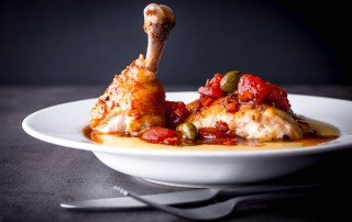 Simple Mediterranean flavours are front and centre of this glorious roasted chicken leg dish which is served over a bed of polenta.