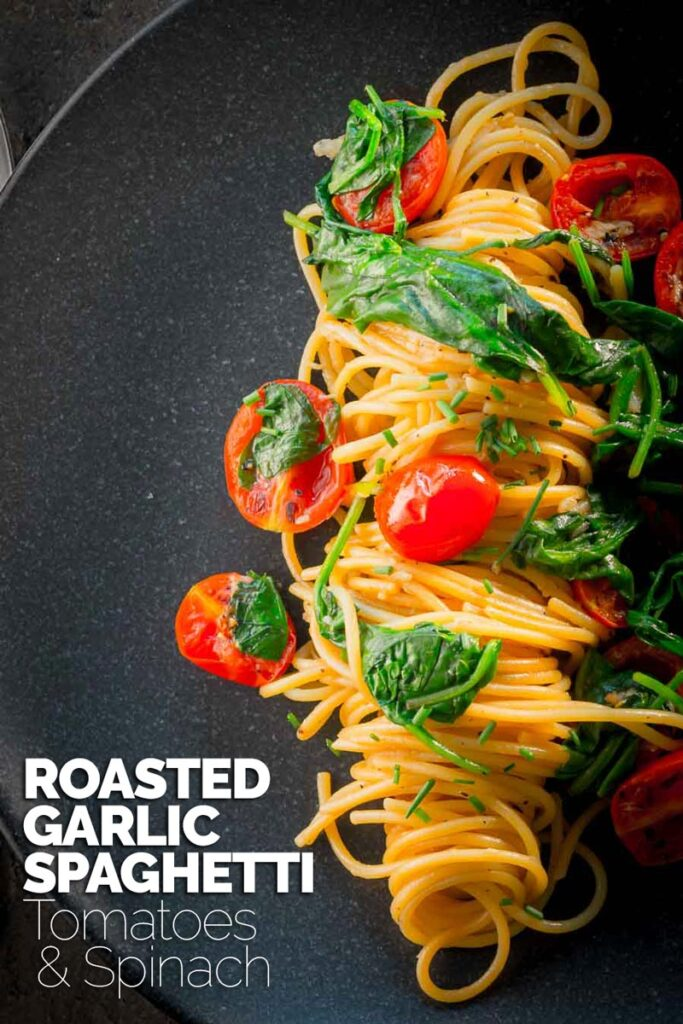 Roasted garlic is a beautiful thing and roasted garlic spaghetti is even better, add some simply seared tomatoes, a bit of spinach and loads of black pepper and you are away