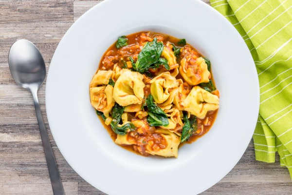 """This tortellini soup is a hearty main course style soup that is crazy quick to make, a perfect midweek pantry """"lifesaver"""" full of great flavours!"""