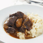 French food is not all picky and fancy, this beef bourguignon or beef burgundy is a French classic featuring a cheaper cut of meat braised in red wine. This stew is ready in an hour thanks to the Instant Pot and is a perfect weeknight dinner. #beefstew #cheapcutsofmeat