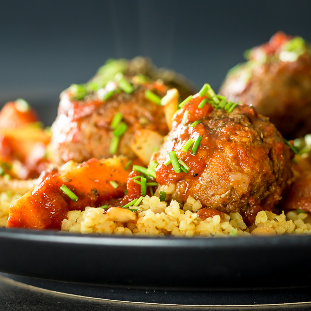 The bed of Harissa spiked bulgar wheat and chickpeas is the perfect bed for these Moroccan inspired beef meatballs, a wonderful winter warmer!
