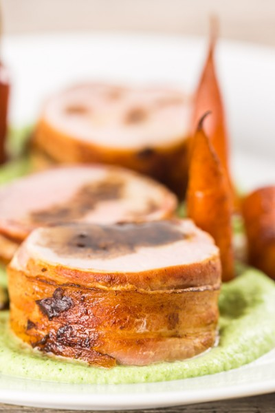 Anything wrapped in bacon is awesome so this simple bacon wrapped baked pork tenderloin really owns it and the whole meal is more simple than it looks. All told this can be on your table in a shade under an hour.