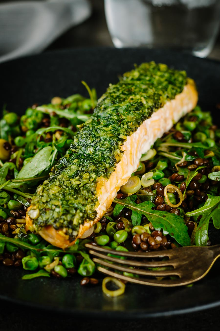 Baked salmon is a beautiful thing and this herb crust salmon is served with a vibrant green warm lentil salad and a simple but great balsamic dressing.