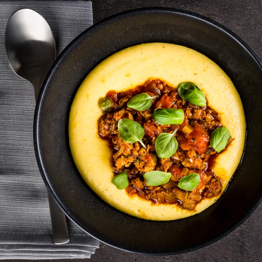 A real hearty and comforting dish, a perfect Italian sausage ragu over a rich and indulgent cheesy polenta, pass me the red wine!