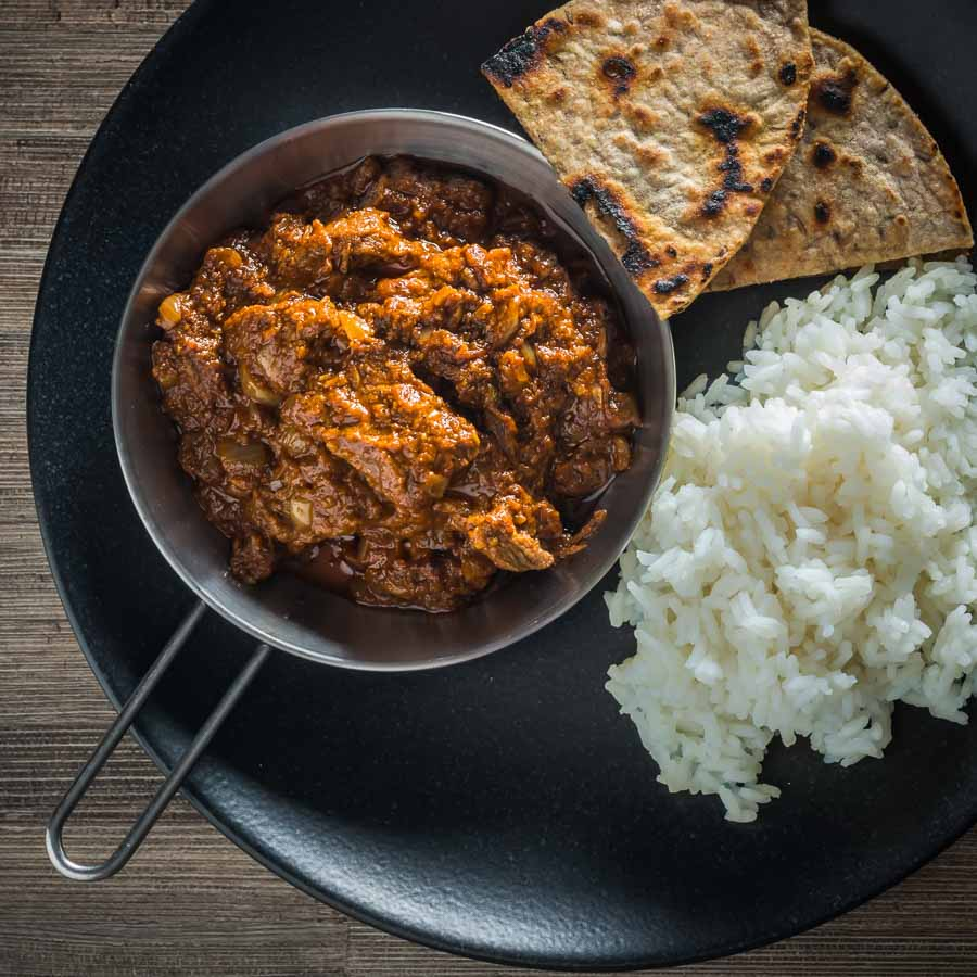 A Madras Curry in the UK has become synonymous with a fiercely hot curry and not much else, my version has more complex flavours but still with a punch of heat from chili and pepper.