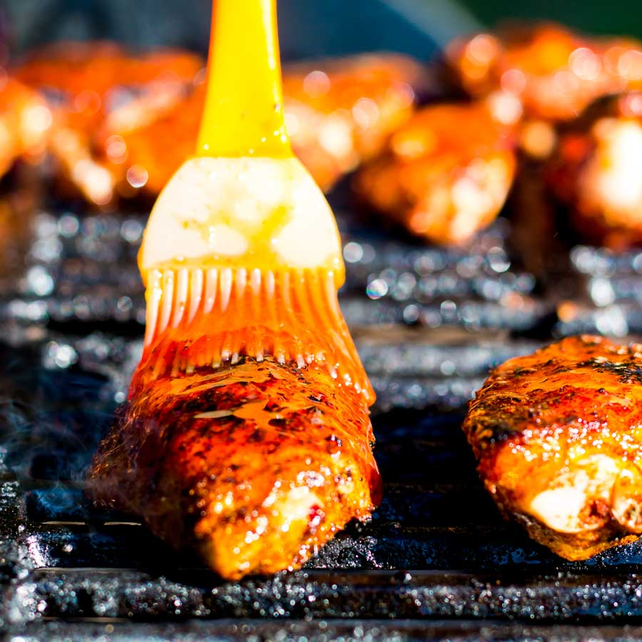 These Sriracha Glazed Grilled Chicken Wings are marinaded in a dry rub before being grilled on the BBQ in a sticky spicy sweet sauce to send them over the edge.