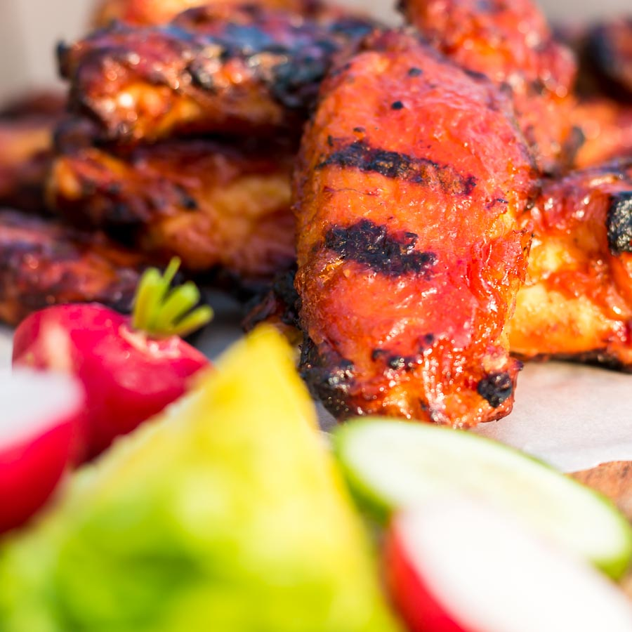 BBQ Chicken Wings are always a thing of great beauty, but the Mango Glaze on these bad boys push them right over the top and are the perfect kick-off to the BBQ Season!