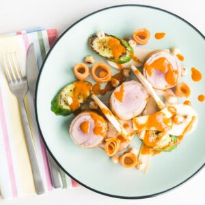 This Pork Tenderloin with Pickled Fennel and Carrots recipe comes with a spicy harissa dressing and is the perfect spring/summer salad that's very un-salad like!