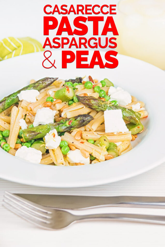 Portrait image of Casarecce Pasta With Peas, Asparagus, Feta cheese and Pine Nuts in a white bowl with text