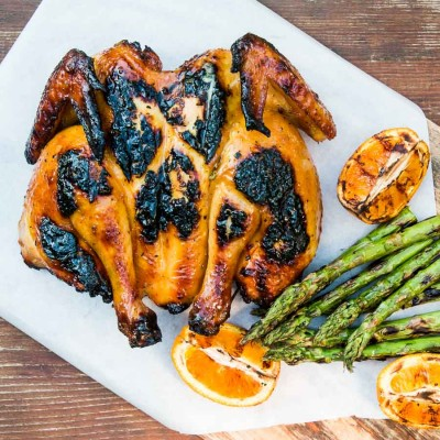A spatchcock chicken is the perfect bird to cook on a grill, and summer is here so let's do this. This grilled spatchcock chook recipe has a glorious orange Marmalade Glaze!