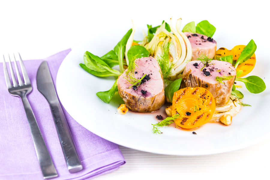 Roast pork tenderloin is the perfect 'quick cook' piece of meat, beautifully tender when cooked pink and served here with gin braised fennel and seared apricots.