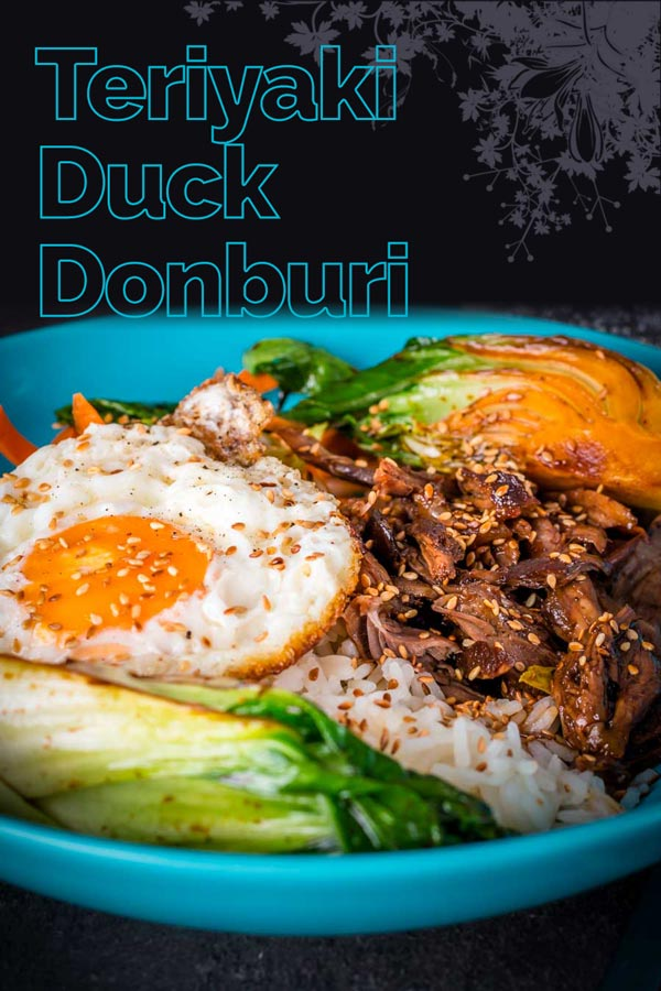 This Shredded Teriyaki Duck Donburi is a beautiful bowl of tasty goodness, slow-cooked duck leg served over rice and a host of other goodies. #duck #ducrecipe #ricebowl #dinnerfortwo #teriyaki #recipeideas #recipeoftheday #recipes
