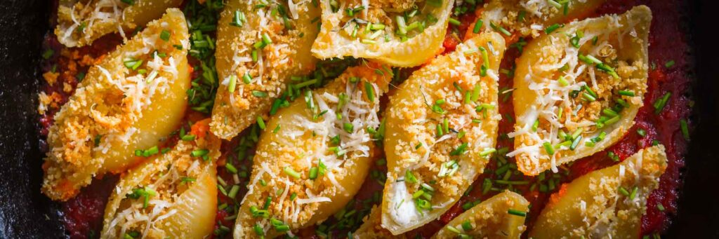 I love stuffed pasta shells and these glorious treats are stuffed with salami and goats cheese and baked in the oven in a cast iron skillet.