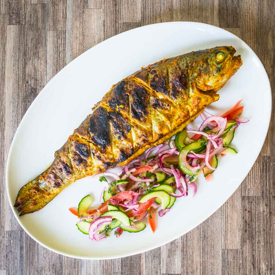 The barbecue is a great substitute for a tandoor oven as this whole BBQ tandoori fish demonstrates. A whole trout in glorious Indian Spices cooked to perfection!