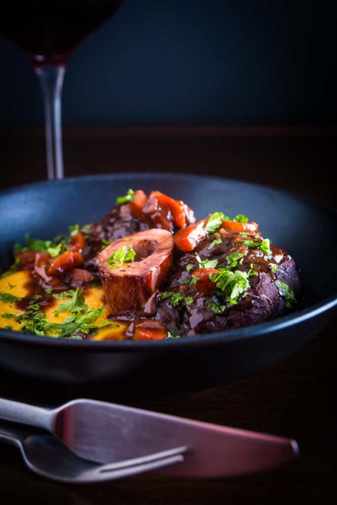 Portrait image of Osso Buco made with beef shin served with polenta