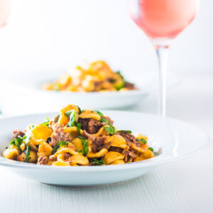Pork Ragu that tastes like it has been slow cooked for 24 hours in an hour or so thanks to the Instant Pot served with hearty Orecchiette Pasta.