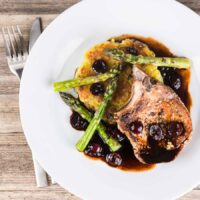 Pan Fried Pork Chops With Balsamic Cherries and Potato Rosti