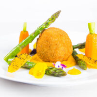Confit Duck Leg Bonbons with Carrot Puree and Asparagus